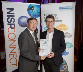 Patrick Richardson of Eye-C-3D (right), University of Ulster, pictured with category sponsor Niall O'Donohoe of IBM after winning the Hi-Tech Award at the NISP CONNECT 25k Awards 2013, sponsored by Bank of Ireland