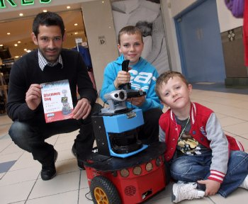 """Research student Emre Ozbilge, with Eoin Doherty and his friend Caolan Cooper, working a mobile pioneer robot during a display by the University of Ulster's Intelligent Systems Research Centre (ISRC) at Foyleside shopping complex. It was a """"taster"""" event for """"Discovery Day"""" this Saturday (Sept 25) when the ISRC"""