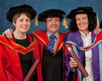 Dr Jacqueline O'Connor and Dr Aine McKillop, pictured with Head of School Professor Neville McClenaghanat the Millennium Forum graduation ceremony