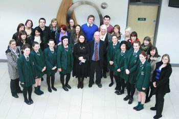 University of Ulster's Dr Roger Austin (centre) with his students alongside pupils and staff from St Cecilia's College in Derry.