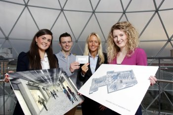 University of Ulster architecture students, Carrie Gillespie, William Brewster and Sarah Mitchell are presented with their prize for winning Victoria Square's 'Reface the Base' design competition by Aline Djaider, UK real estate manager, Commerz Real AG (second from right).