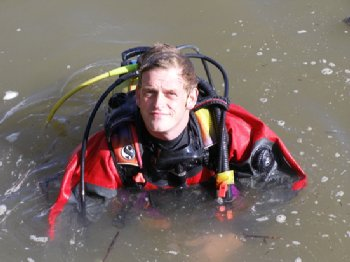 Rory McNeary, from the Centre for Maritime Archaeology at Coleraine, taking part in the underwater excavation in the River Drava